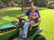 On the riding lawnmower with Grandad