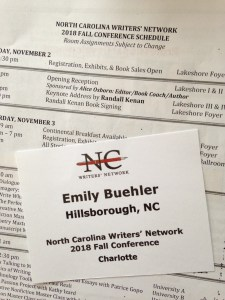 my name badge from the conference and part of the schedule