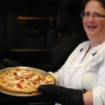 Chris shows off her pizza