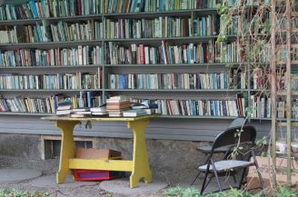 outdoor bookshelves in a store, filled with books