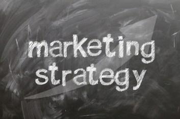 """the words """"marketing strategy"""" written on a chalkboard"""