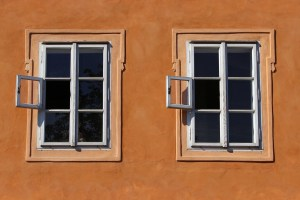 two identical 6-paned windows in a wall
