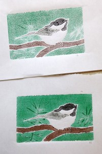 two versions of a block print of a chickadee
