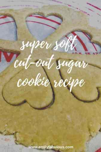 super soft sugar cookie dough rolled out with heart shapes cut out