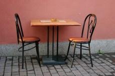 Three legged chair at a cafe in Novi Pazar.