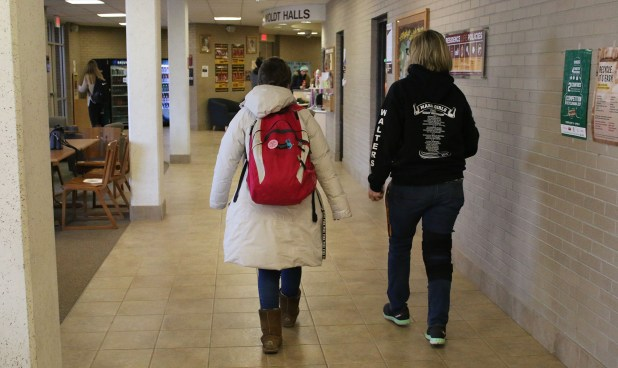 Students walk towards Woldt and Emmons Halls, on the campus of Central Michigan University, Monday, February 27, 2017.