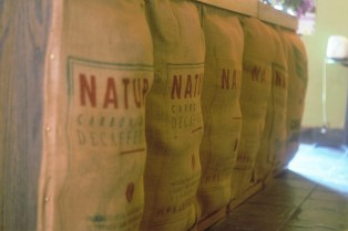 Kaya continues its rustic theme with these burlap coffee bean bags displayed at the front of the counter.