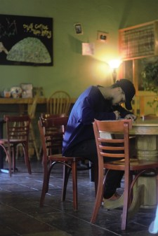 Central Michigan University student Ryan Austin Smith studies for finals at Kaya Coffee House. Ryan never visited Kaya's previous location.