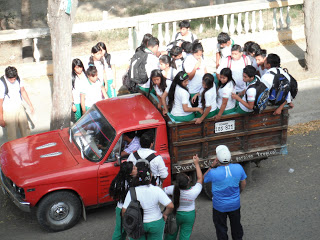 School kids in back of truck