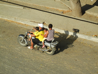Family of four on motorcycle