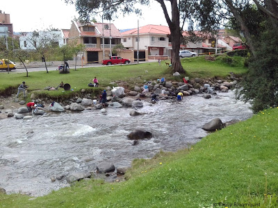 Washing laundry in Tomebamba River, Cuenca, Ecuador