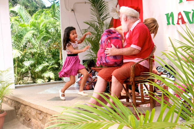 Getting Christmas gifts from Papa Noel