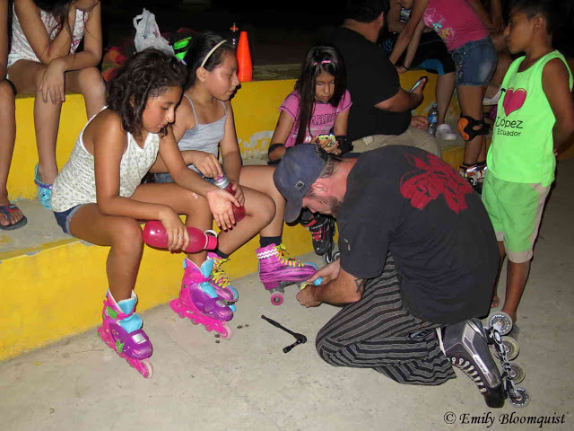 Profesor Matthew fixing skates after practice