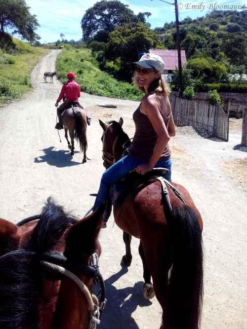 Horseback riding through small towns