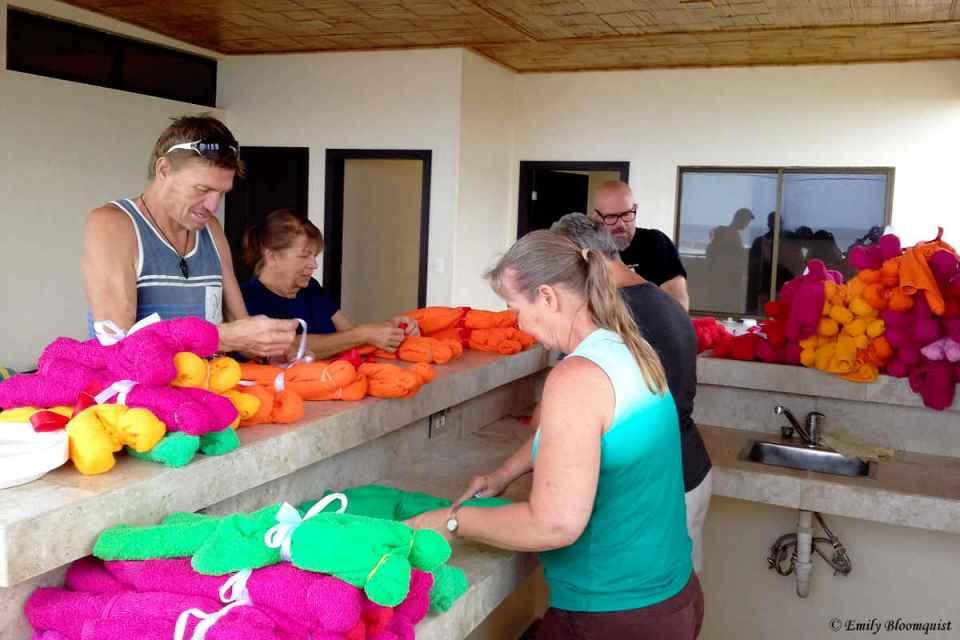 Volunteers turning bath towels into teddy bears