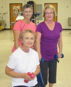 Silver Foxes Darlene Haygood, Peggy Price, and Ann Augustin working with weights
