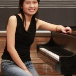 Emily Lau sitting at piano