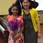 Emily and girl student at piano recital