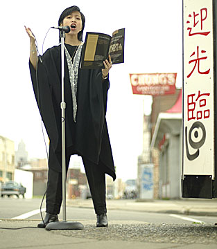 Emily P. Lawsin performs guerilla poetry on the sidewalks of Detroit's abandoned Chinatown.