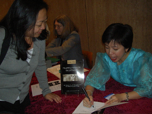 Emily Lawsin signs books after her speech at the Smithsonian, Oct 2004