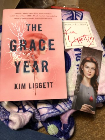 Signed The Grace Year by Kim Liggett with a Bookmark