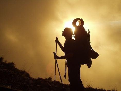 trekking backpack sunset silhouette climbing