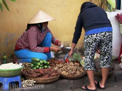 Selling vegetables at Hoi An Market