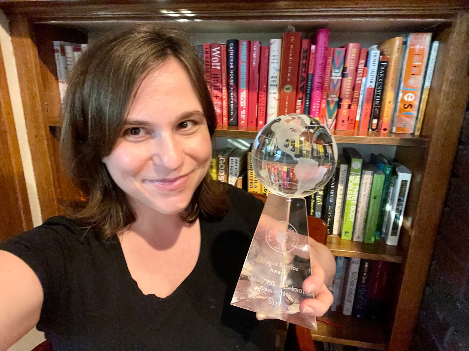 Emily P.G. Erickson with her 2021 Alumni Service Award from Macalester College