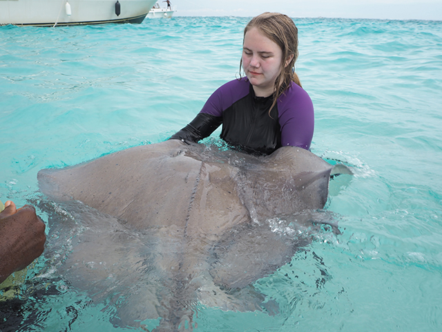 Emily holding a stingray at Stingray City Cayman Islands