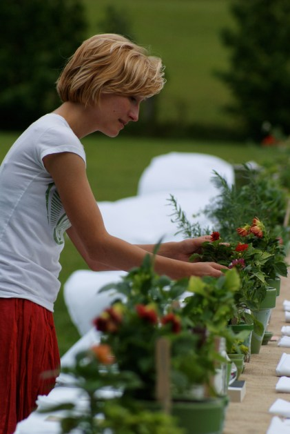Claire puts finishing touches on the reception table decor. Photo by Suzy Shelton