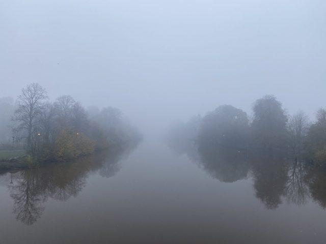 A foggy river scene