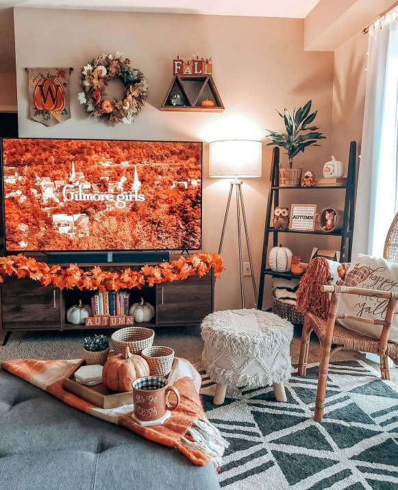 fall living room with pumpkins, leaves and orange accents