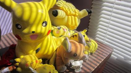 A bunch of pikachus and a raichu on the top of a dresser