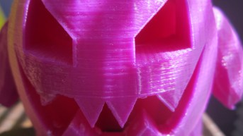 A closeup of the pokemon Gengar, in a figurine form