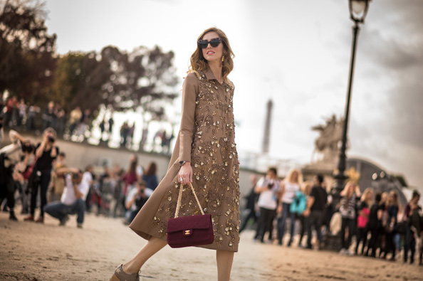 Chiara Ferragni is wearing a dress from Rochas a bag from Chanel sunglasses from Dsquared and shoes from Stella McCartney.