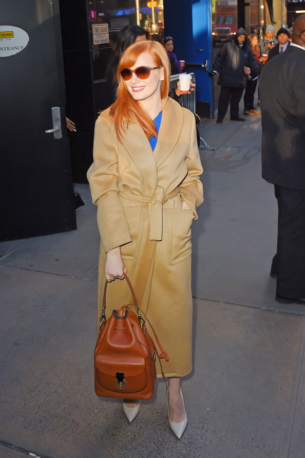 64b7c102bc Jessica Chastain with Ricky Drawstring bag in gold