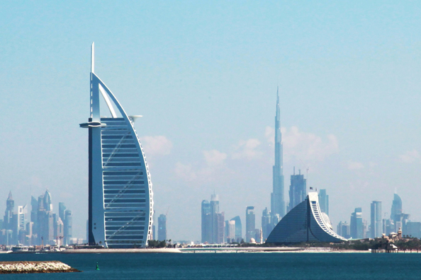 The Burj Al Arab Hotel Left And Jumeirah Beach Right Operated By Group LLC Together With Khalifa Worlds Tallest Tower