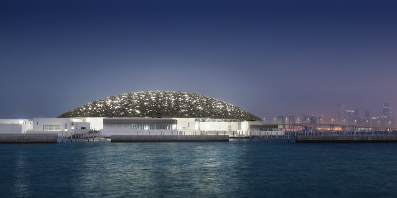 The Louvre Abu Dhabi at night.