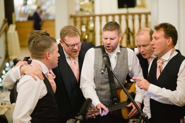 groom singing at wedding