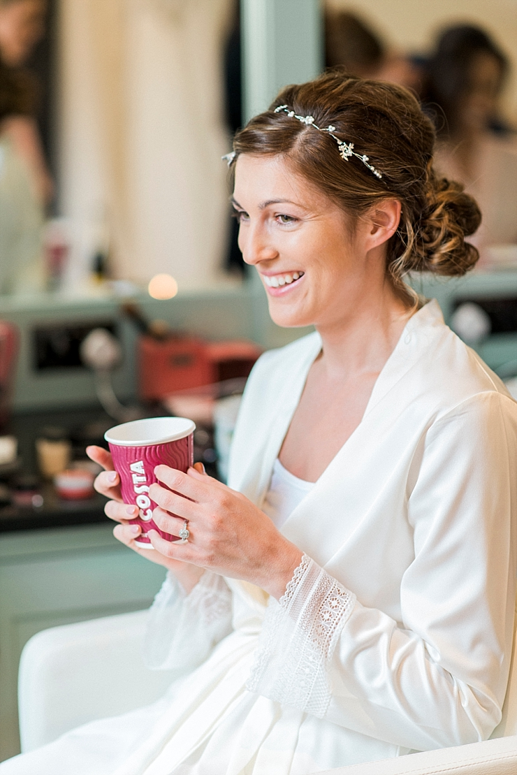 bride with costa cup
