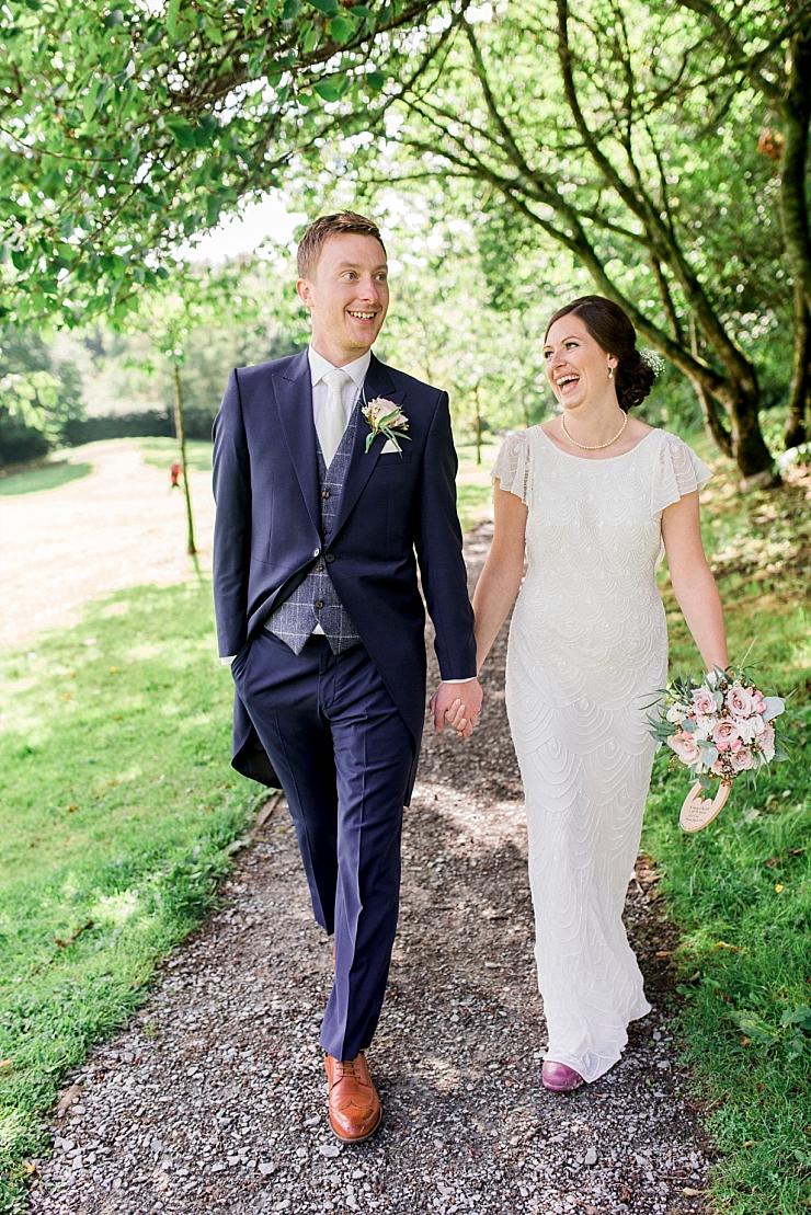 bride and groom in windermere