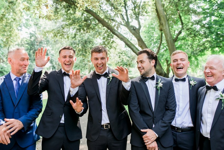 groomsmen laughing together