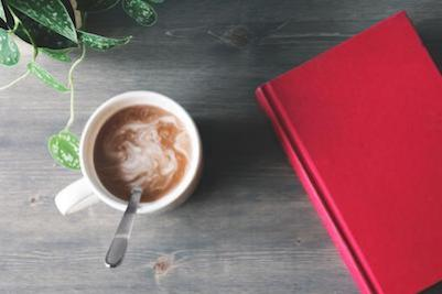 Ultimate checklist: how to overcome stress and anxiety. Hot chocolate and a book.