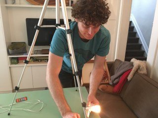 My adorable husband helping to set up the lights for the video shoot