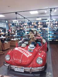 A car in a hat shop, because, why not?!