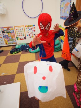 Spiderman proudly shows off his balloon ghost