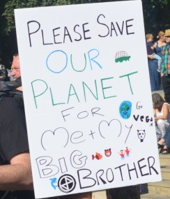 There is an Extinction Rebellion sticker is at the bottom of the poster
