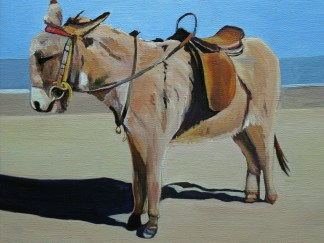 Painting of a donkey on a beach