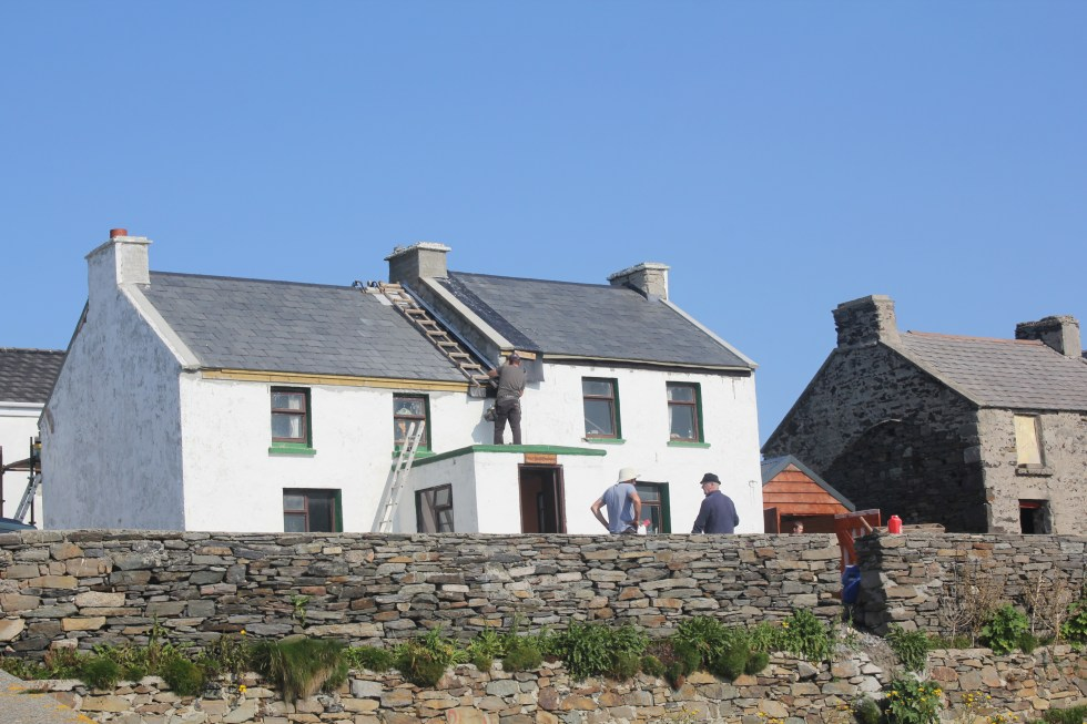 Inisbofiners working on a roof