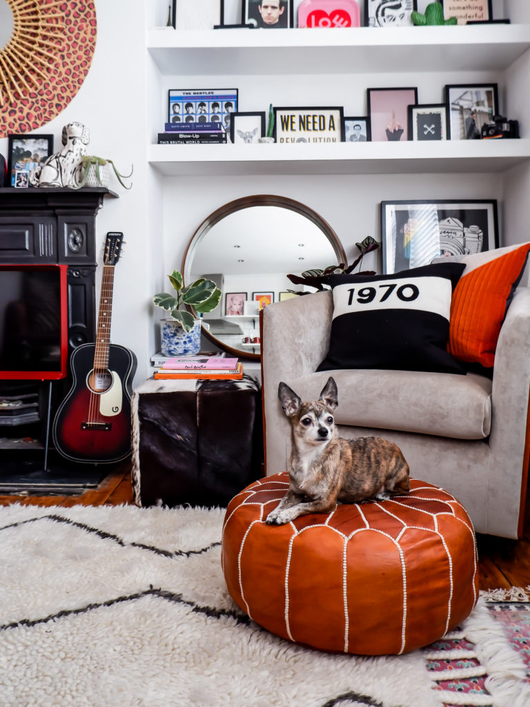 Bohemian living room corner with mid-century swivel chair and artwork